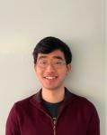 Headshot of John Yang.