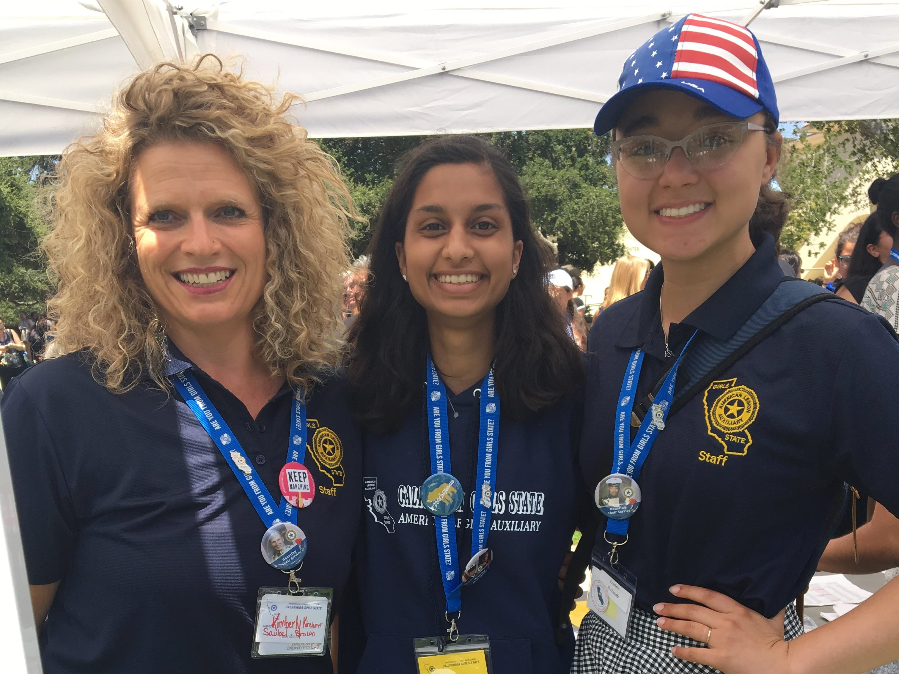 Eman Khatri, center, with two female staff from California Girls State on either side.